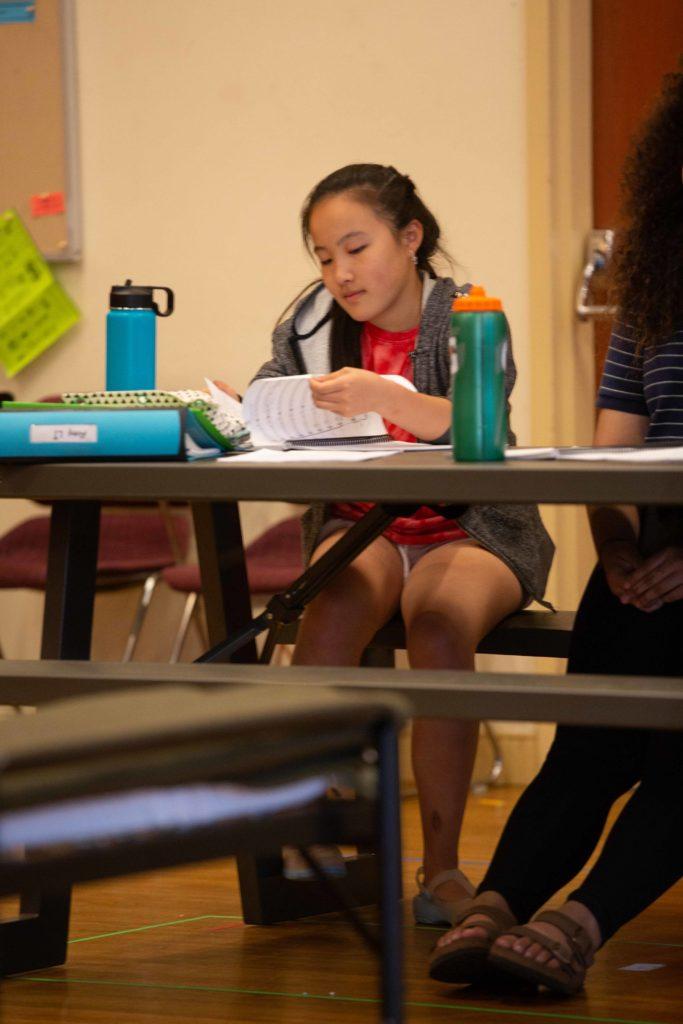 Amy Li (child Singa) looking through her score